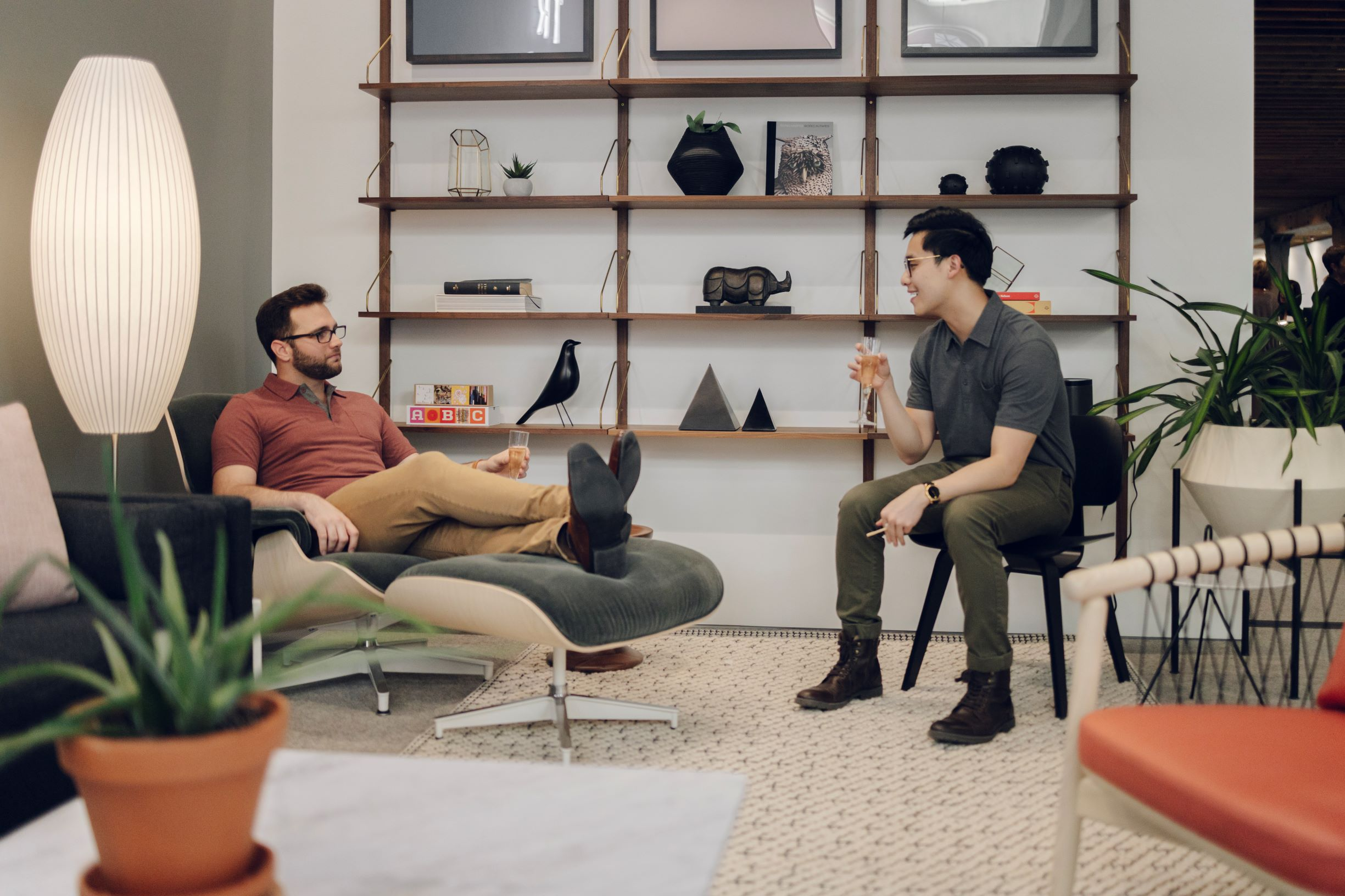 Guys talking in Eames lounge area - resized